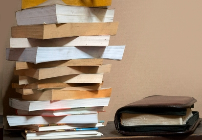 A stack of books and the Bible for the Purposeless Driven Life article
